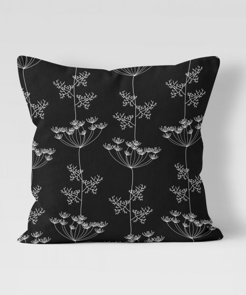 black pillow with frilly flower graphic